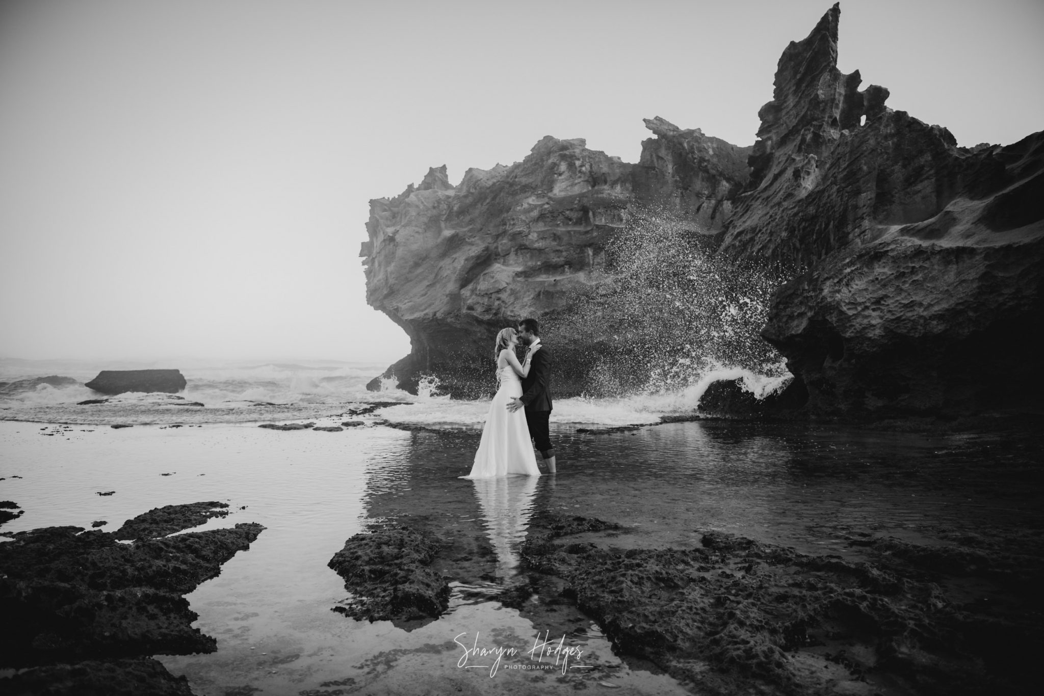 Lucia & Neil's trash the dress shoot took place during a misty sunset at Brenton On Sea in Knysna, photography by Sharyn Hodges.